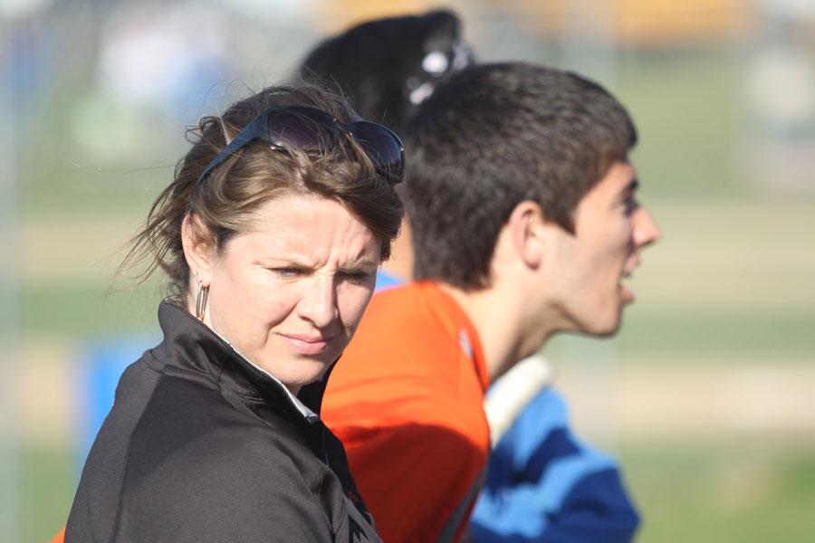 Coach Woodbury stands at a match alongside captain Josh McCauley.