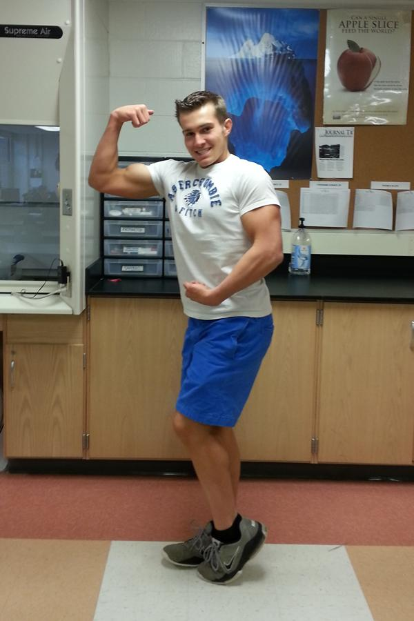 Junior Mike Cohen strikes a pose showing off his hard-fought muscles.