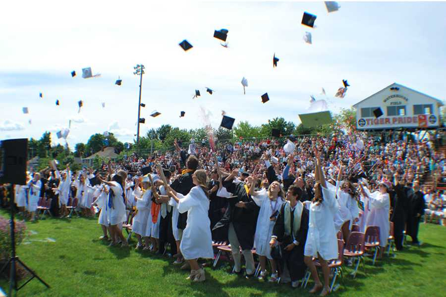 The Class of 2014 throws their caps and shoots some confetti at the end of their graduation ceremony.