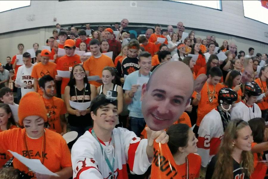 Evan Loignon sings along with his class at the 2014 Homecoming Rally