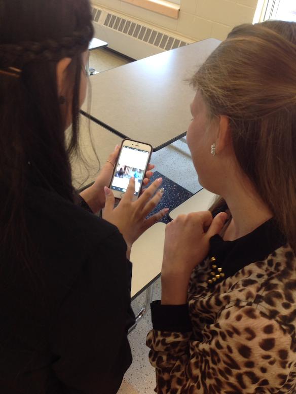 Gaby Bermeo and Riley McNeil look at Vine videos.