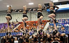 Biddeford cheerleaders compete at the state cheerleading championships at the Augusta Civic Center. (Photo courtesy of the Portland Press Herald. Photo by Brianna Soukup)